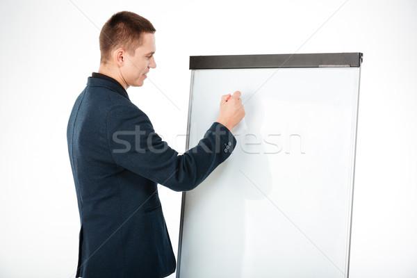 Zakenman schrijven iets geïsoleerd witte Stockfoto © deandrobot