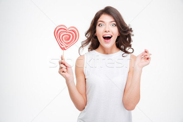 Portrait of a cheerful woman with lollipop Stock photo © deandrobot