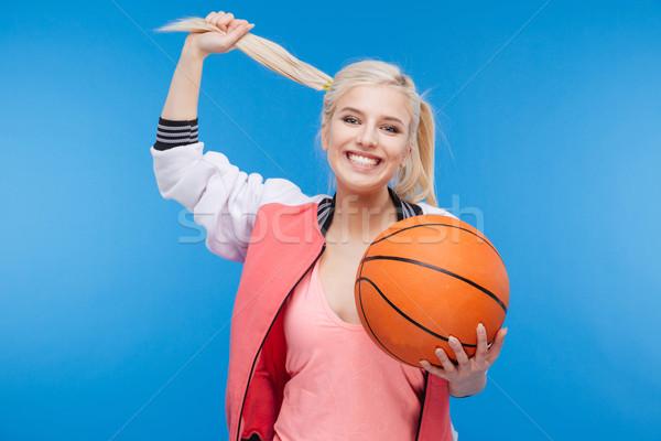Smiling woman holding basketball ball Stock photo © deandrobot