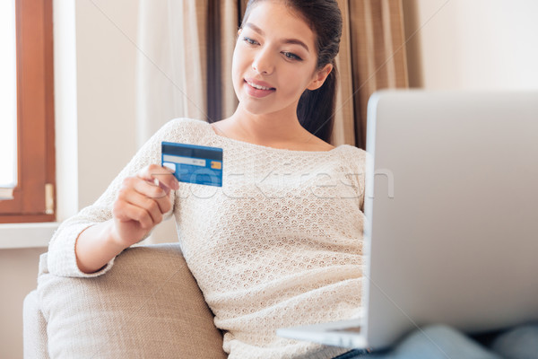 Woman with laptop computer and credit card Stock photo © deandrobot