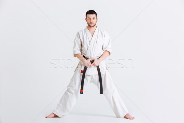 Adam kimono bakıyor kamera yalıtılmış beyaz Stok fotoğraf © deandrobot