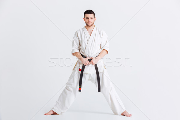 Man in kimono looking at camera Stock photo © deandrobot