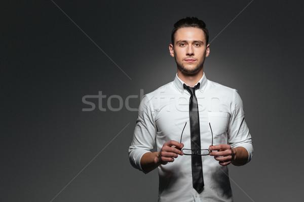 Stock fotó: Vonzó · fiatal · üzletember · fehér · póló · nyakkendő