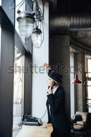 Stock photo: Beautiful stylish blonde girl talking on the phone