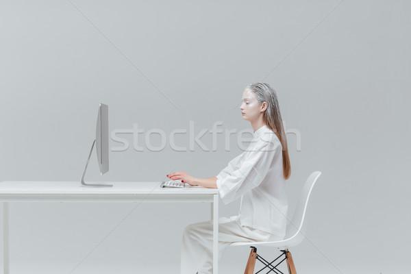 Kadın oturma tablo bilgisayar pc kozmik Stok fotoğraf © deandrobot