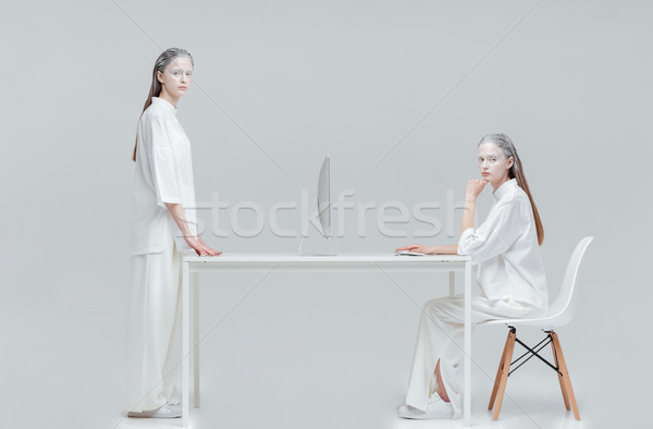 Two women using future technology  Stock photo © deandrobot