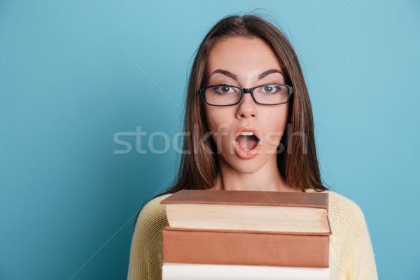 Portre şaşırmış kadın kitaplar Stok fotoğraf © deandrobot