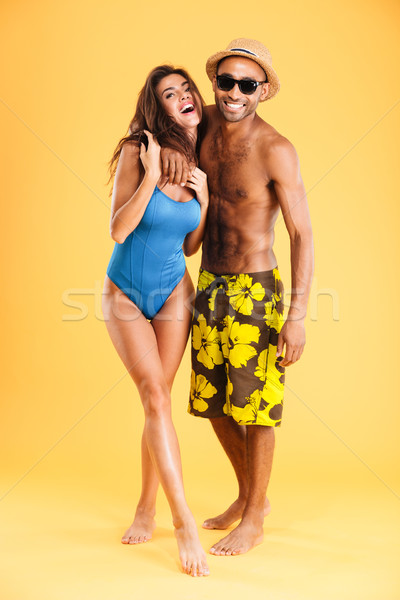 Loving smiling couple in swimwear Stock photo © deandrobot