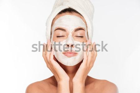 Young beautiful woman with facial mask Stock photo © deandrobot