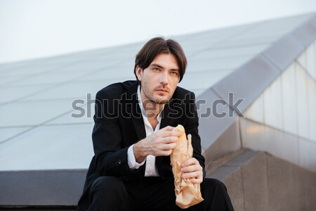 Man in suit with baguette Stock photo © deandrobot
