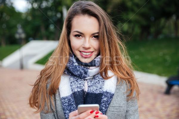 улыбаясь девушки шарф клетке Сток-фото © deandrobot