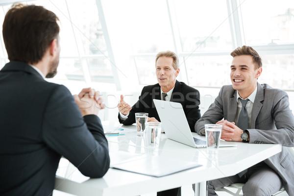 Sorridere Smart uomini d'affari lavoro difficile finanziaria Foto d'archivio © deandrobot