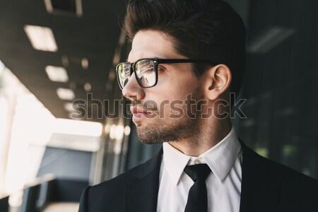 Concentrated african businessman working late at night Stock photo © deandrobot