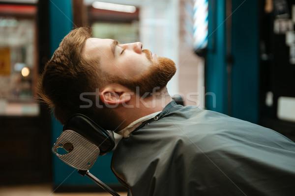 Hombre guapo barba mentiras silla imagen Foto stock © deandrobot