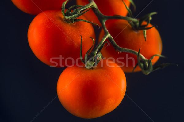 Olgun taze kiraz domates yalıtılmış siyah arka plan Stok fotoğraf © deandrobot