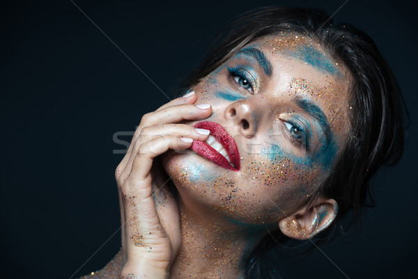 Beauty portrait of gorgeous young woman with blue shining makeup Stock photo © deandrobot