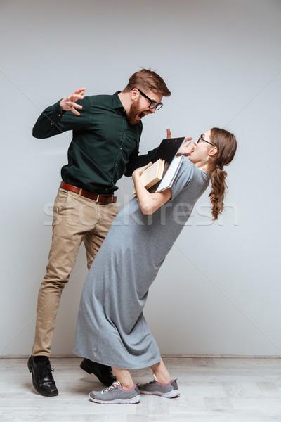 Pionowy obraz brodaty człowiek krzyczeć kobiet Zdjęcia stock © deandrobot