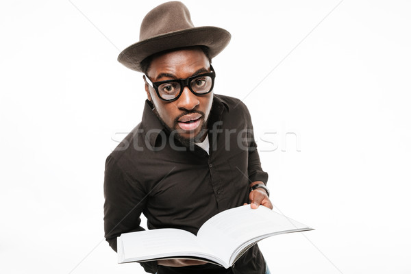 Stock photo: Amazing young african man dressed in shirt wearing hat