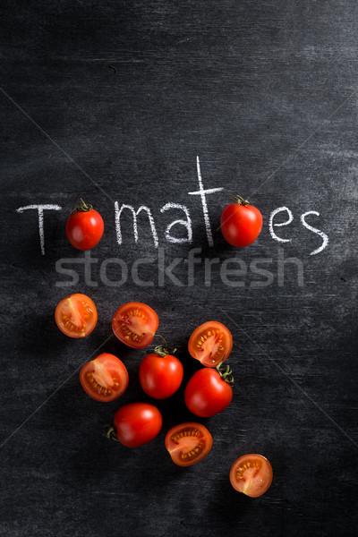изображение Cut помидоров темно Top мнение Сток-фото © deandrobot