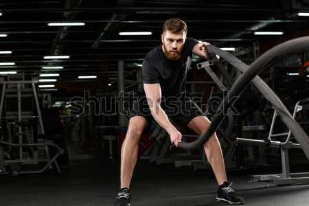 Concentrated strong sports lady make sport exercises with dumbbells Stock photo © deandrobot