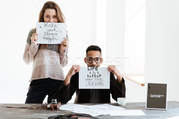 Stock photo: Woman standing near the african man