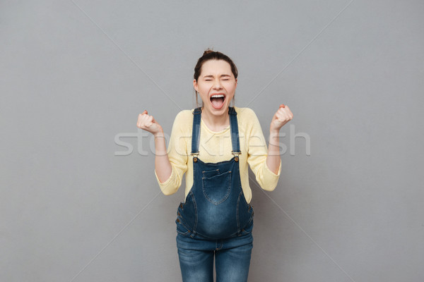 Stock photo: Angry screaming pregnant woman