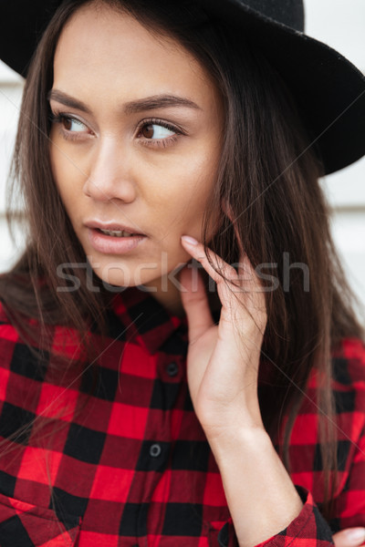 Concentrated young caucasian lady walking outdoors Stock photo © deandrobot
