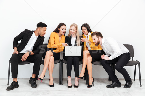 Concentrado colegas sessão escritório usando laptop computador Foto stock © deandrobot