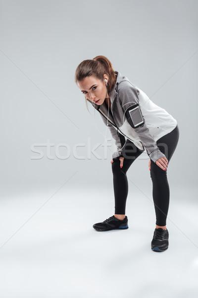 Verticaal afbeelding moe vrouwelijke runner warm Stockfoto © deandrobot