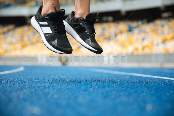 Close up of a male legs in sneakers jumping Stock photo © deandrobot