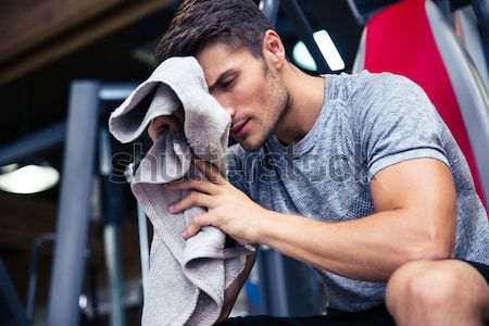 Portrait of boxer training in gym Stock photo © deandrobot