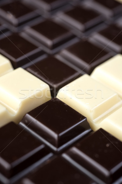 Dark and white chocolate bars combined in a pattern Stock photo © deandrobot