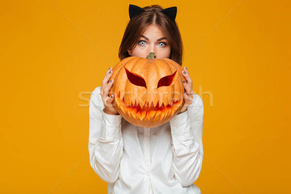 Shocked young woman dressed in crazy cat halloween costume Stock photo © deandrobot
