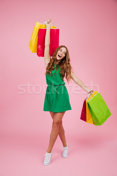 Full length portrait of a happy cheerful woman in dress Stock photo © deandrobot