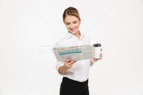 Mosolyog szőke nő üzletasszony olvas újság tart Stock fotó © deandrobot