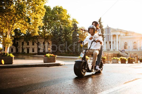 Zdjęcie radosny Afryki para motocykl Zdjęcia stock © deandrobot