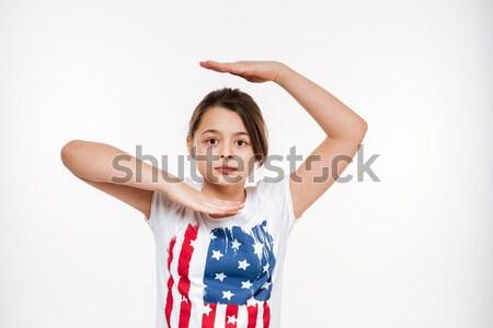 портрет недоуменный азиатских девушки Постоянный рук Сток-фото © deandrobot
