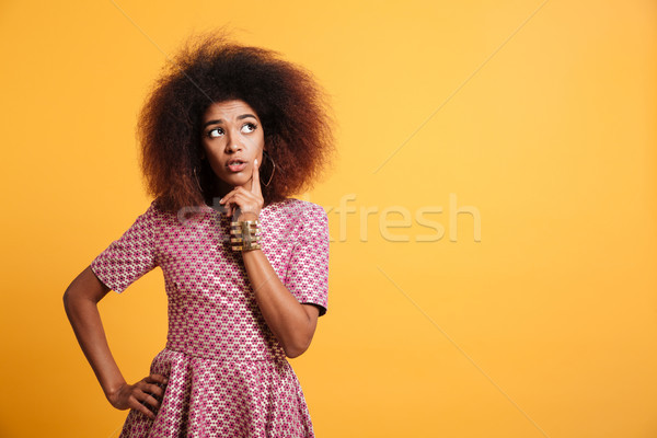 Close-up portrait of retro stylish african thinking wooman touch Stock photo © deandrobot