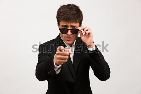 Portrait of a focused concentrated man in suit Stock photo © deandrobot