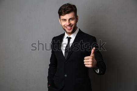 Giovani sorridere uomo barbuto imprenditore punta Foto d'archivio © deandrobot