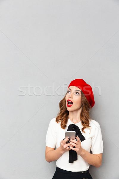 портрет удивленный школьница равномерный мобильного телефона Сток-фото © deandrobot