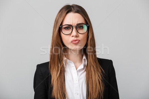 Serious businesslady frown and looking camera isolated Stock photo © deandrobot