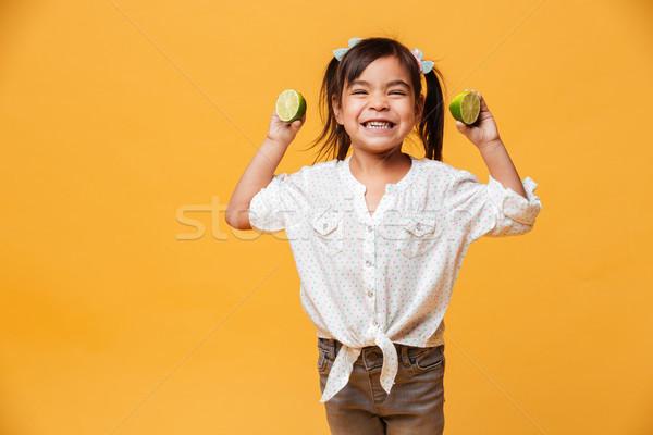 Kislány gyermek tart citrus fotó áll Stock fotó © deandrobot