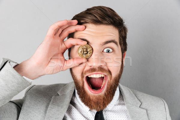 Close up a joyful businessman dressed in suit Stock photo © deandrobot