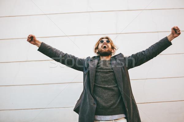 Portrait of a successful bearded man wearing sunglasses Stock photo © deandrobot