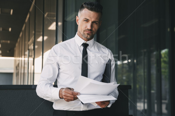 Portrait of a successful young businessman Stock photo © deandrobot