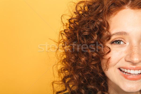 Half gezicht glimlachend gekruld Stockfoto © deandrobot