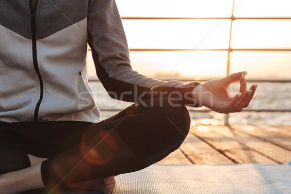 Kép fiatal lány meditál ül fitnessz víz Stock fotó © deandrobot