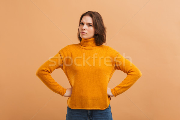 Portrait of an upset young woman in sweater Stock photo © deandrobot