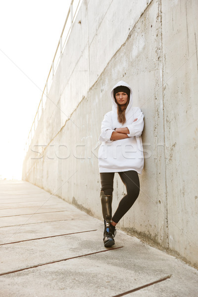 Photo of serious young handicapped woman having bionic leg in st Stock photo © deandrobot